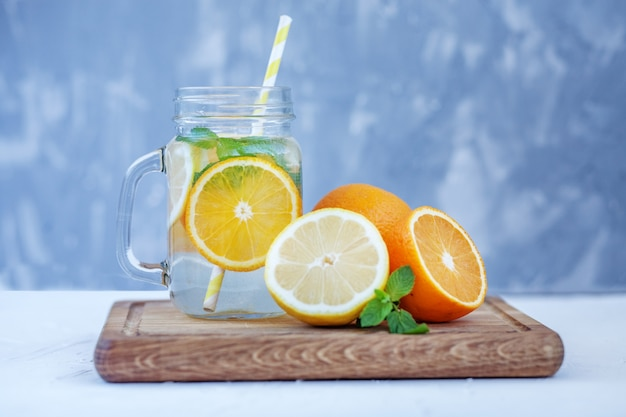 Refreshing fruit water with lemon, orange and mint.