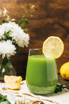 Refreshing green smoothie with lemons