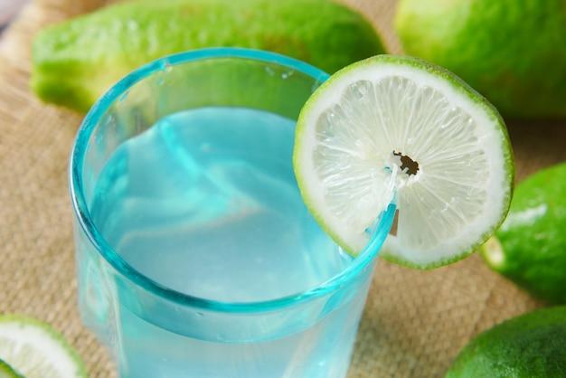 Refreshing lemon water drink on table  top view