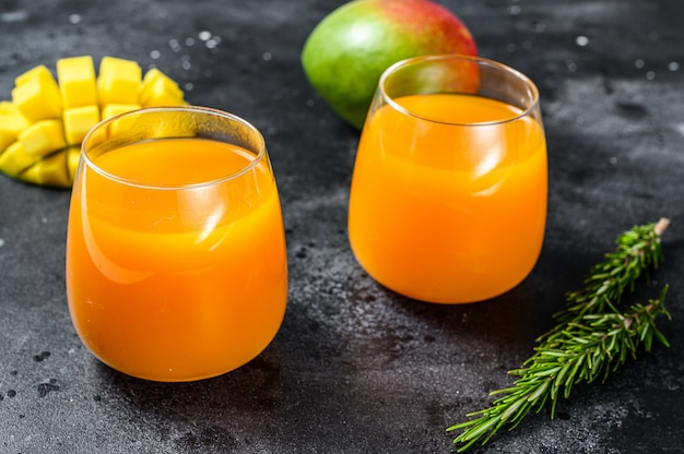 Refreshing mango juice in a glass. top view