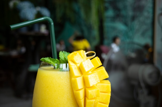 Refreshing mango smoothie in a glass, mango shake. tropical fruit concept