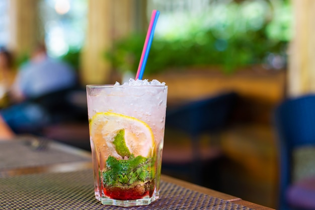Refreshing mojito with crushed ice on a hot summer day