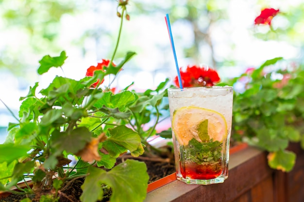 Refreshing mojito with crushed ice on hot summer day
