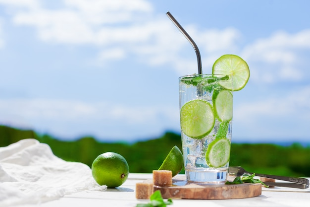 Refreshing mojito with lime in a glass