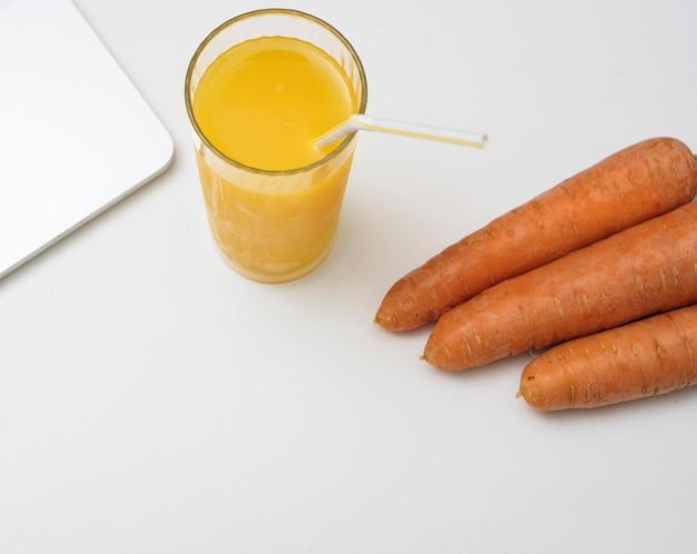 Refreshing orange juice and carrots