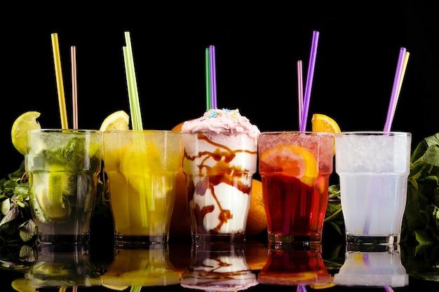 Refreshing summer cocktails over black background