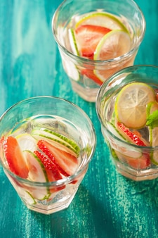 Refreshing summer drink with strawberry cucumber lime in glasses