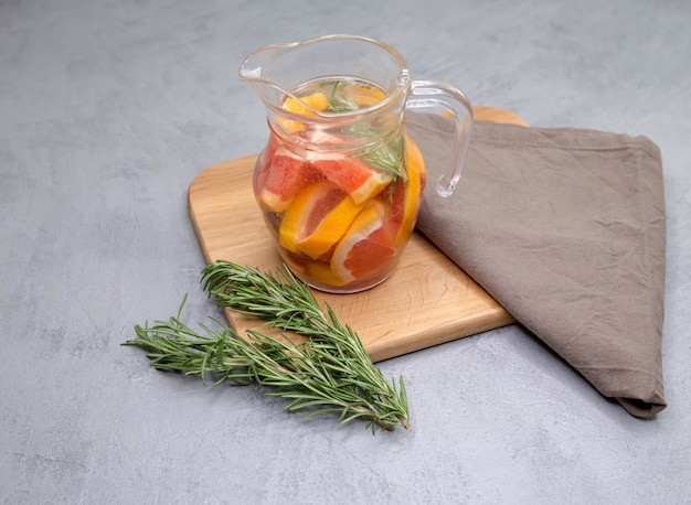 Refreshing summer homemade cocktail with grapefruit and rosemary