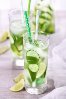 Refreshing tonic with slices of cucumber, mint, lime