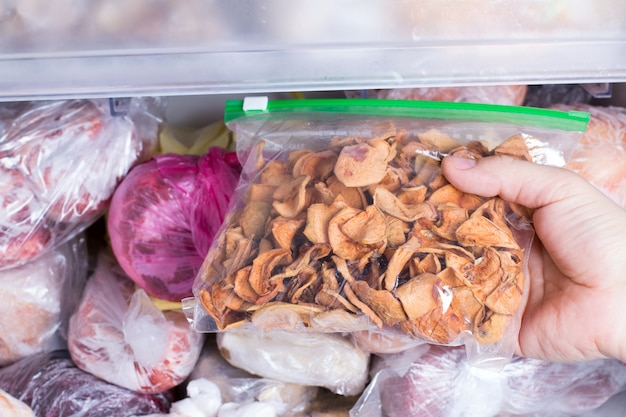 Refrigerator with frozen dried fruits in a package