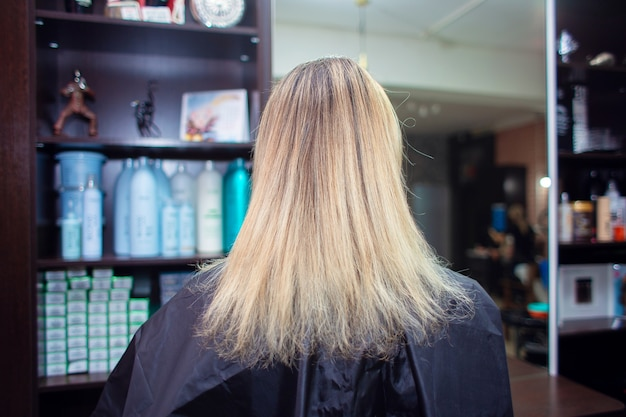 Regrown hair with split ends. the woman came to the hairdresser to dye her hair and cut her hair.