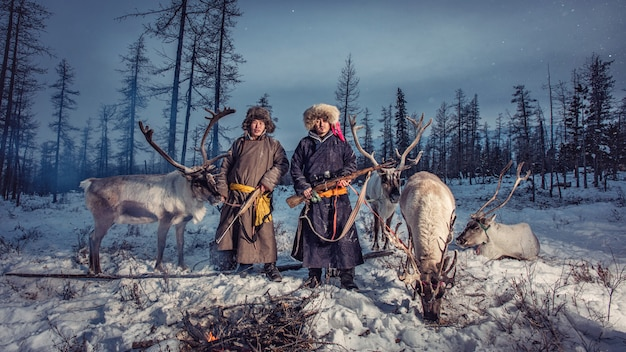 Reindeer herders camp on the background near russia border at taiga, mongolia