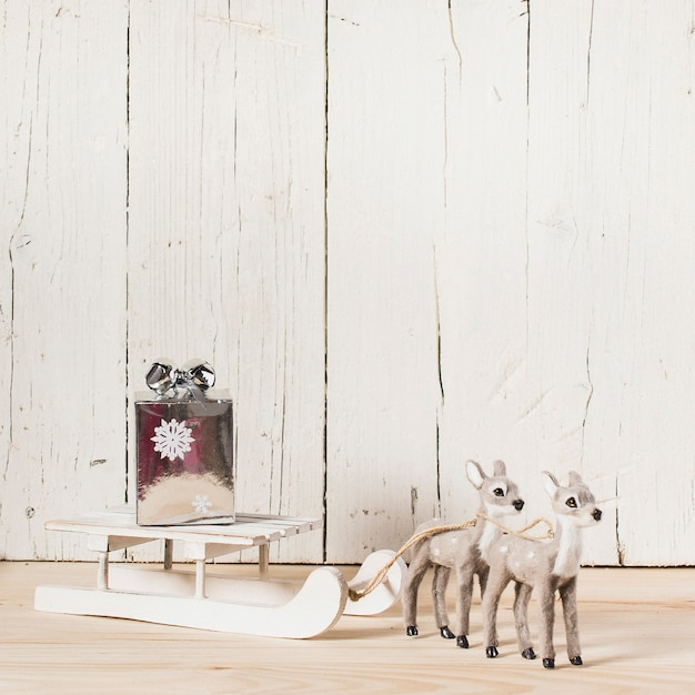 Reindeer pulling the sleigh with copy space on top