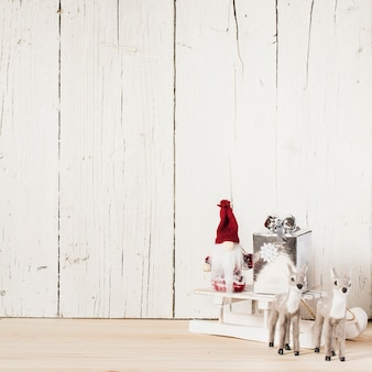 Reindeer and santa claus with christmas gifts