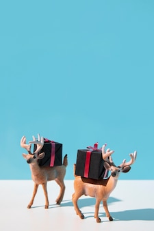 Reindeers carrying christmas presents