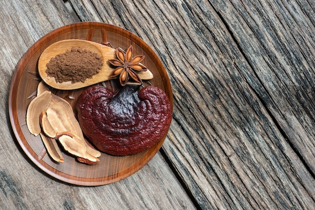 Reishi or lingzhi mushroom ,slices and powder in nature.