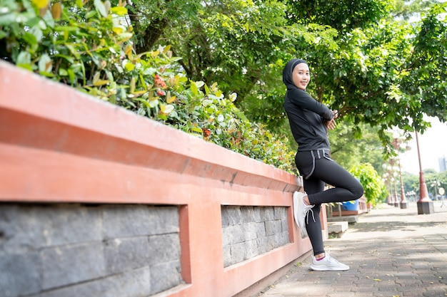 Relax muslim woman athlete exercise her body outdoor in the park