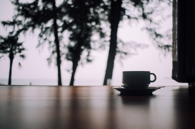 Relax scene of coffee cup on the floor in the morning.