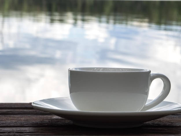 Relax time, empty white cup of coffee with river