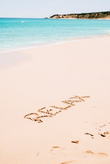 Relax word on tropical beach landscape