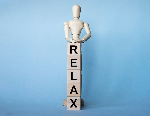Relax word written on wooden cube blocks