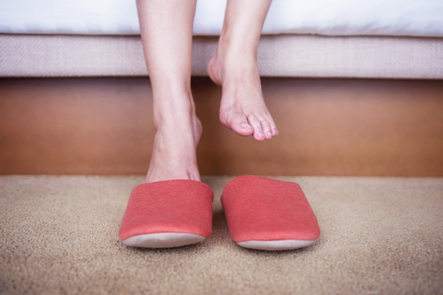 Relaxation and comfortable concept. person waking up in the morning and put on slipper sho