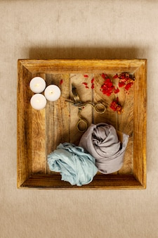 Relaxation ritual, candles and dried flowers on wood