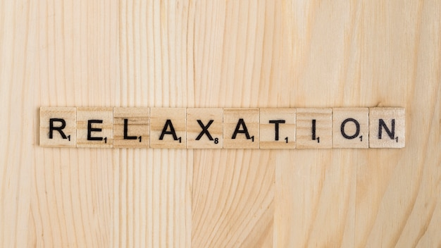 Relaxation word on wooden tiles