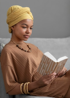 Relaxed arab woman reading a book at home