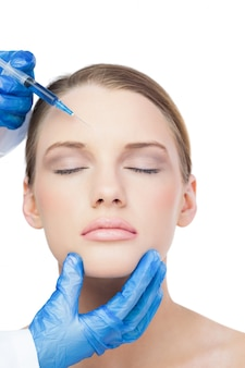 Relaxed attractive model having botox injection on the forehead