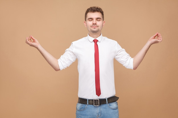 Relaxed businessman doing yoga poses