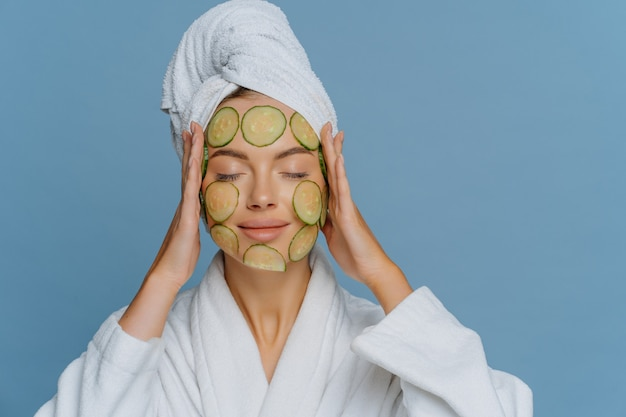 Relaxed european woman undergoes beauty treatments uses natural cosmetology keeps eyes closed