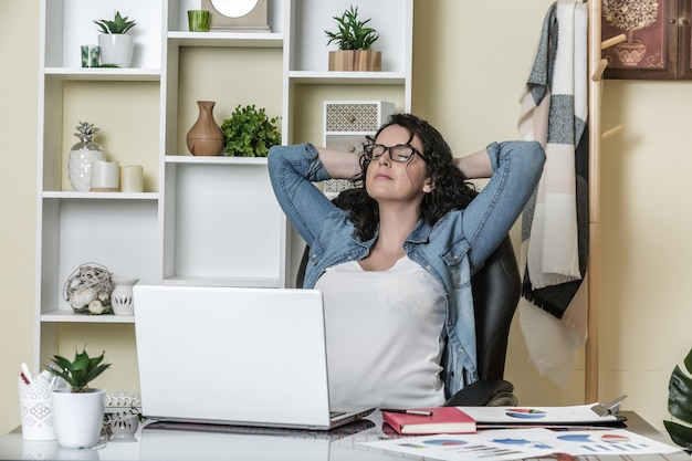 Relaxed freelancer in home office