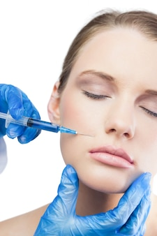 Relaxed gorgeous model having botox injection bove the lips