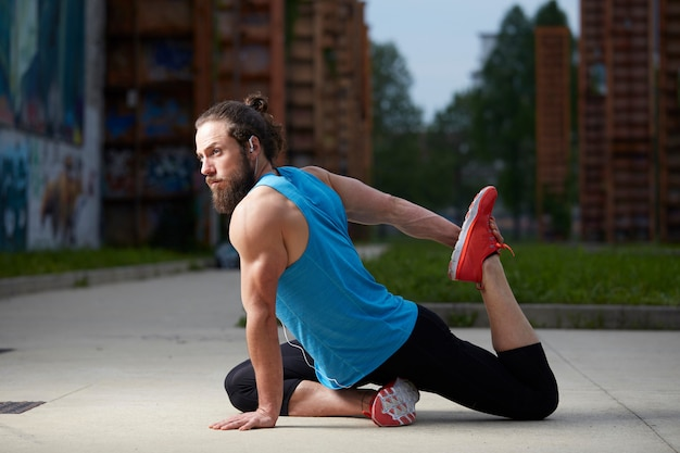Relaxed handsome man doing yoga exercise