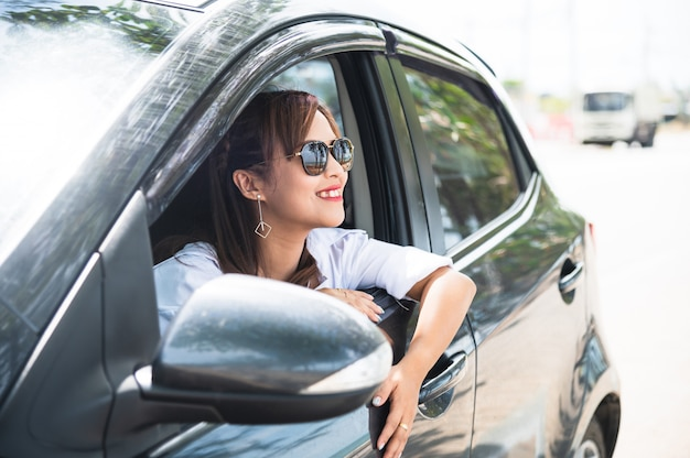 Relaxed happy asian woman on summer roadtrip travel vacation