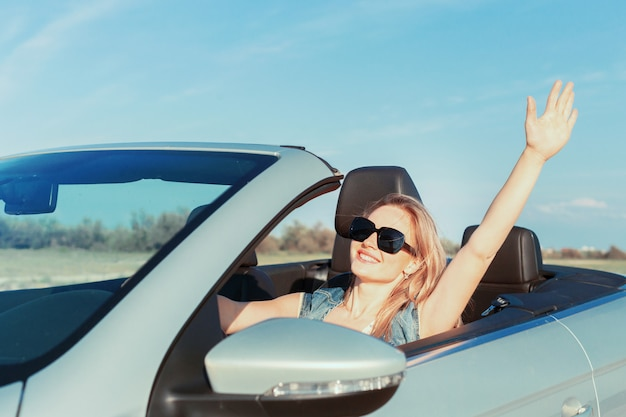 Relaxed happy woman traveling in a car