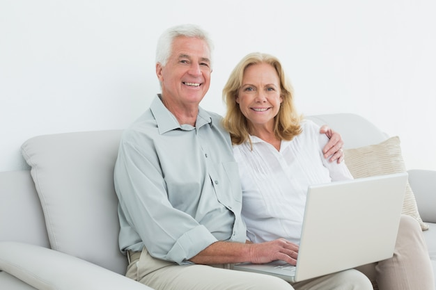 Relaxed loving senior couple using laptop