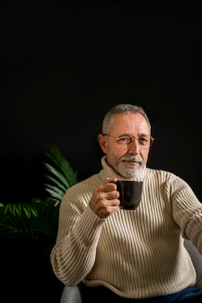 Relaxed senior man with hot beverage