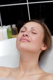 Relaxed woman having a bath