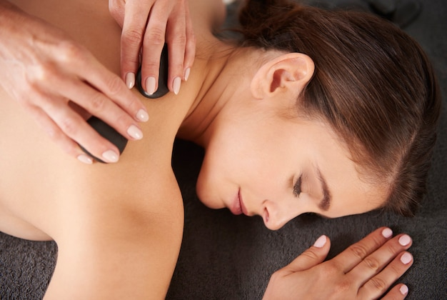 Relaxed woman lying at the spa salon