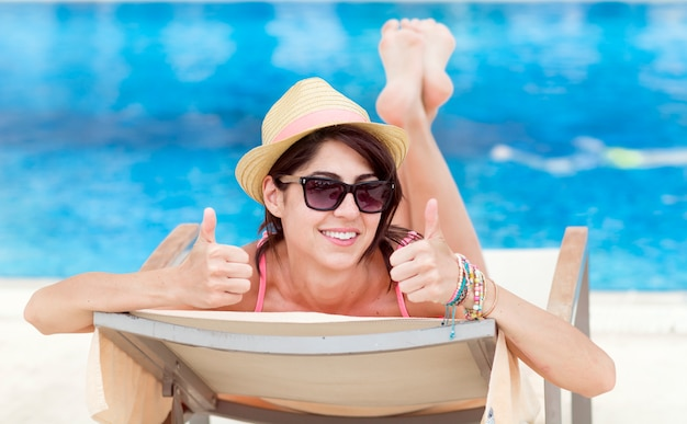 Relaxed woman showing thumbs up