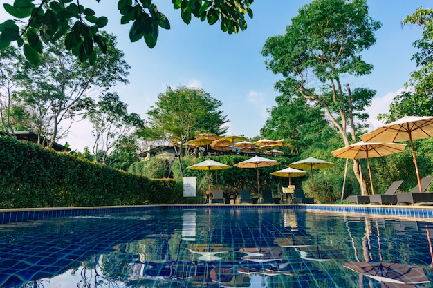 Relaxing area beside swimming pool