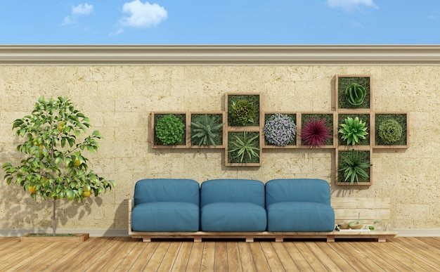 青い木製ソファーでリラックスできるカラフルな庭園