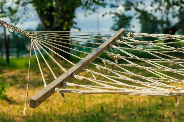 Relaxing lazy time with hammock in the green forest