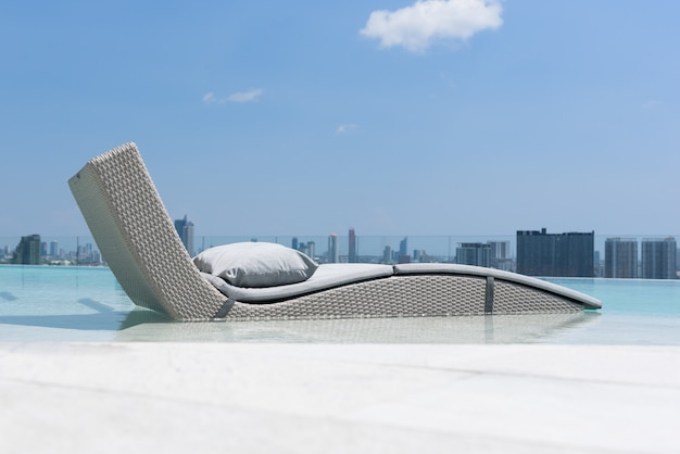 Relaxing or leisure bed in swimming pool with blue sky and cloud