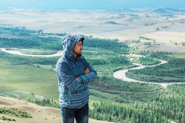 Relaxing man in kurai steppe on north-chui ridge