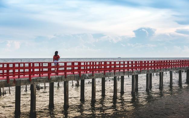 Relaxing travel on red bridge on ocean in summer set