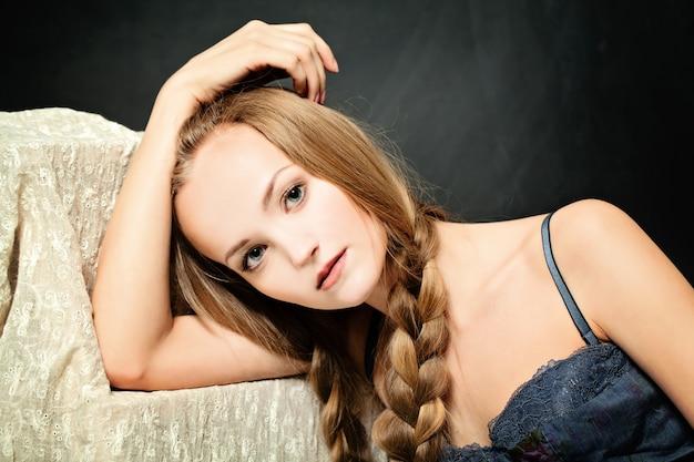 Relaxing woman on dark background. fashion portrait