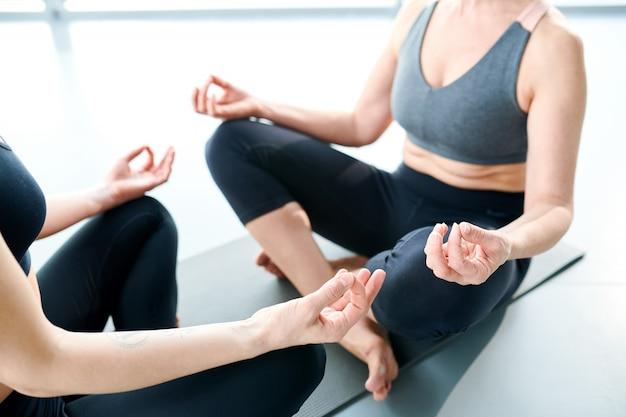 Relaxing yoga. women on mat doing yoga